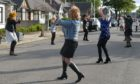 Residents of Norfolk Road dancing to entertain their neighbours.