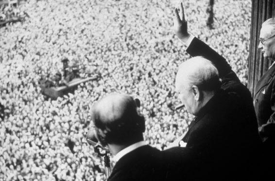 Mandatory Credit: Photo by Shutterstock (159999a) WINSTON CHURCHILL WINSTON CHURCHILL WAVING TO CROWD ON VE DAY - 08 MAY 1945