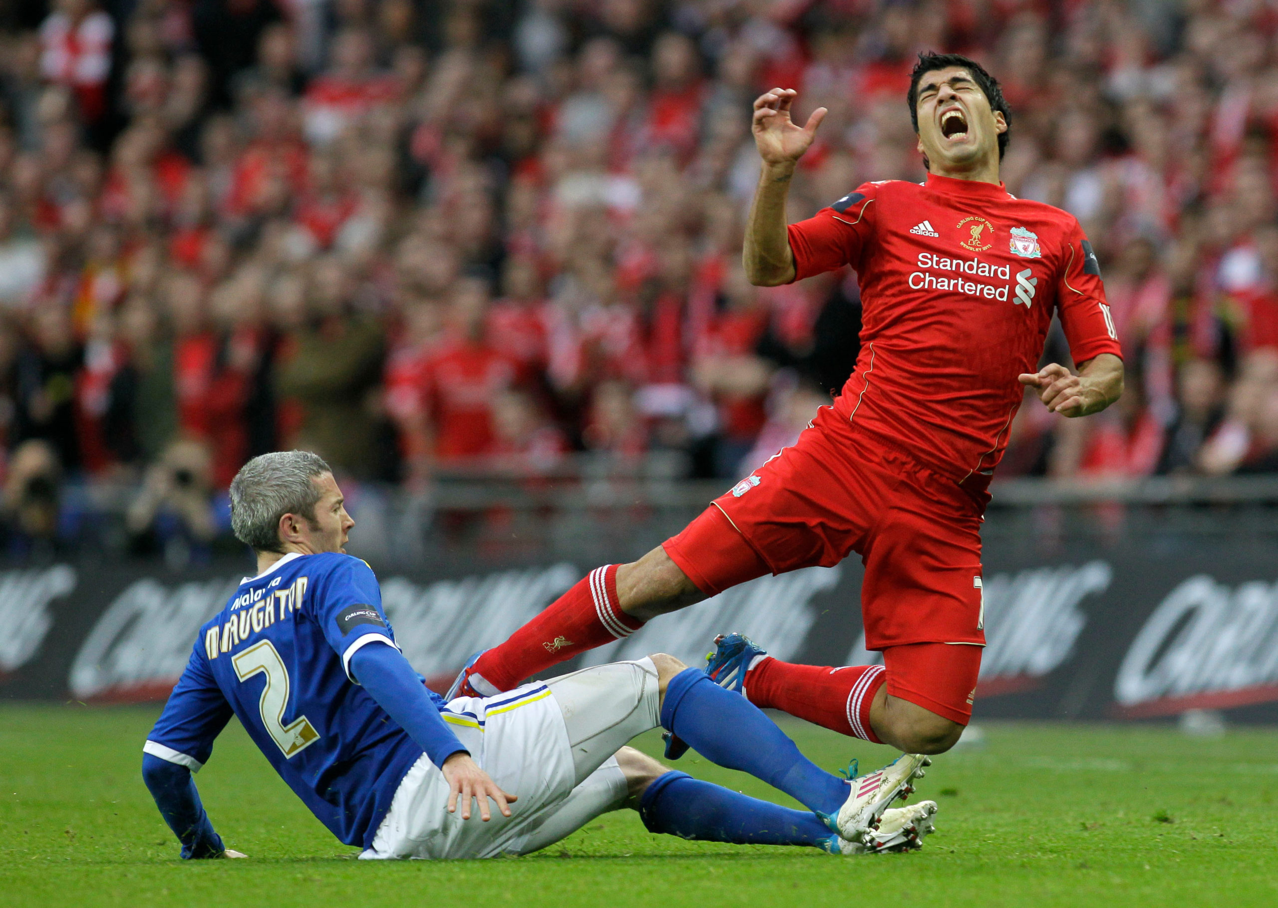 Cardiff City's Kevin McNaughton, left, tackles Liverpool's Luis Suarez during the English League Cup final in 2012.
