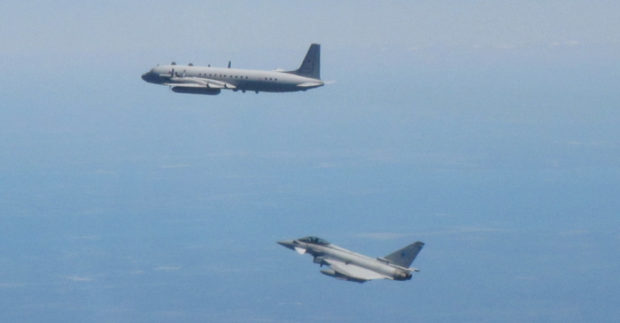 A Russian surveillance plane is shadowed by an RAF Typhoon.