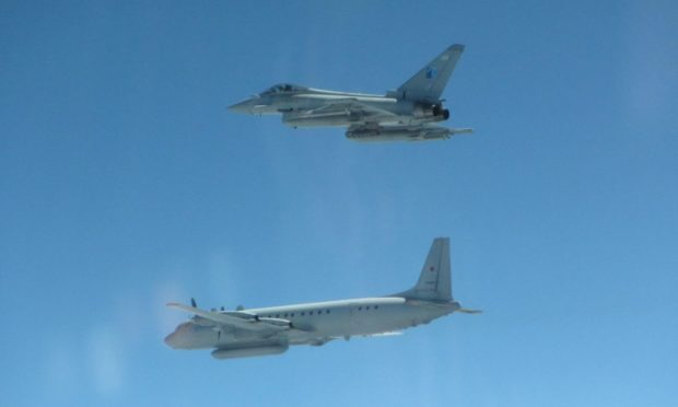 An RAF Typhoon and a Russian IL-20 COOT A after Typhoons were scrambled from Siauliai Air Base.