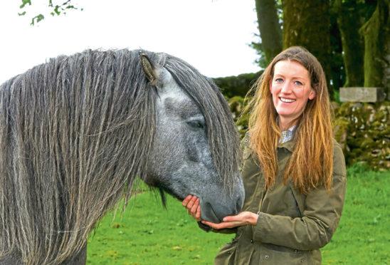 Virginia Osborne-Antolovi is one of the horse section judges.