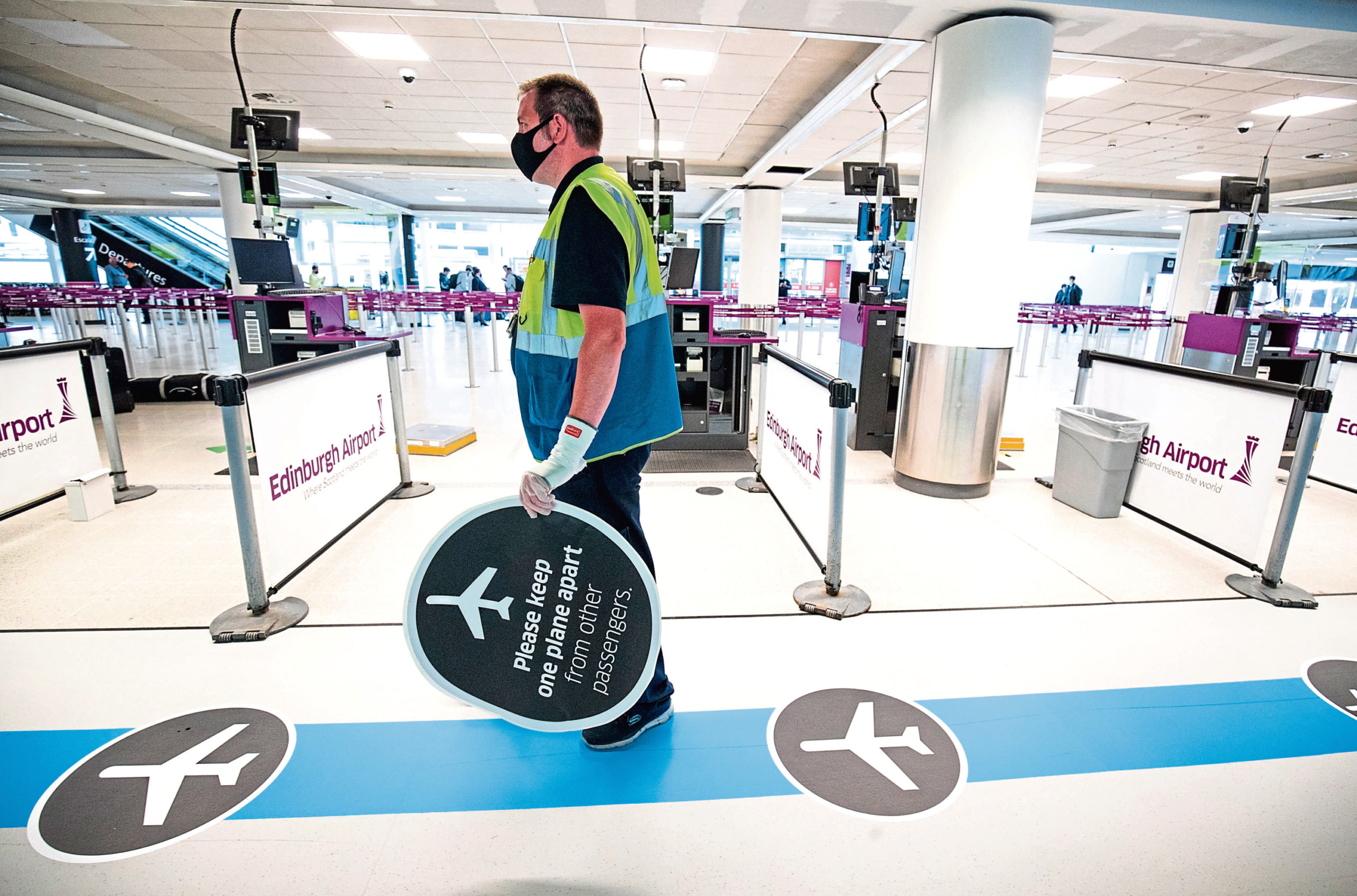 A one-way system has been put in place through Edinburgh Airport, one of the social distancing measures to help limit contact with airport staff and travellers.