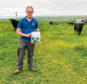 Orkney farmer Pete Moss with one of NFU Scotland's (NFUS) next generation posters.