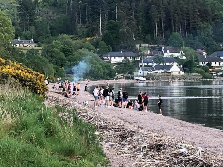 Youths gathered on the banks of Loch Ness