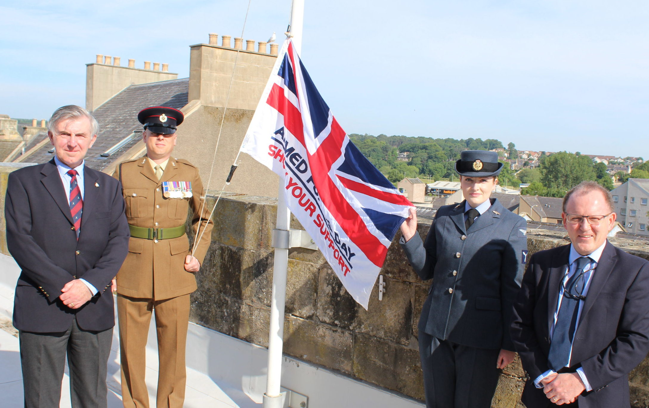 The Armed Forces Day flag is hoisted above Moray Council's headquarters.