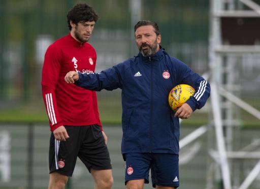 Aberdeen manager Derek McInnes with Scott McKenna at training.