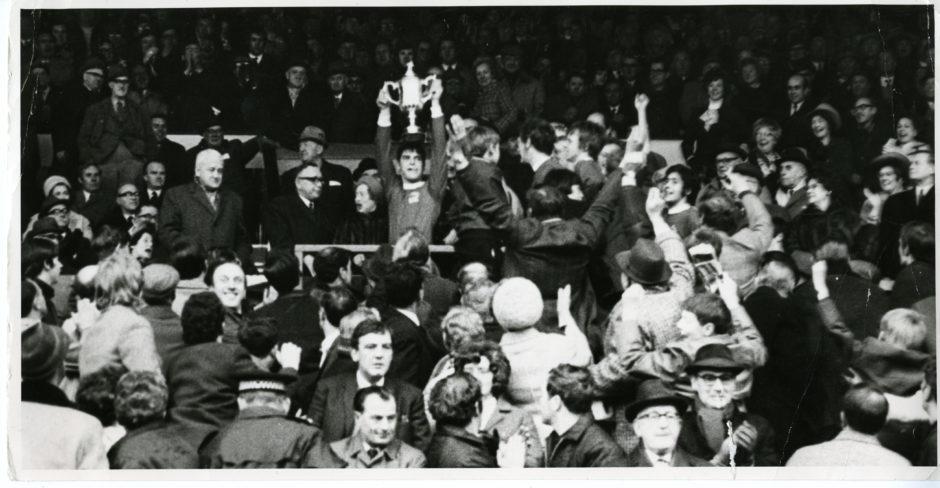 Martin Buchan, Aberdeen FC captain, holds aloft the Scottish Cup having beaten Celtic FC 3-1 at Hampden Park, Glasgow, in 1970.