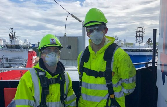Niall MacLeod (Right) docked at Aberdeen
