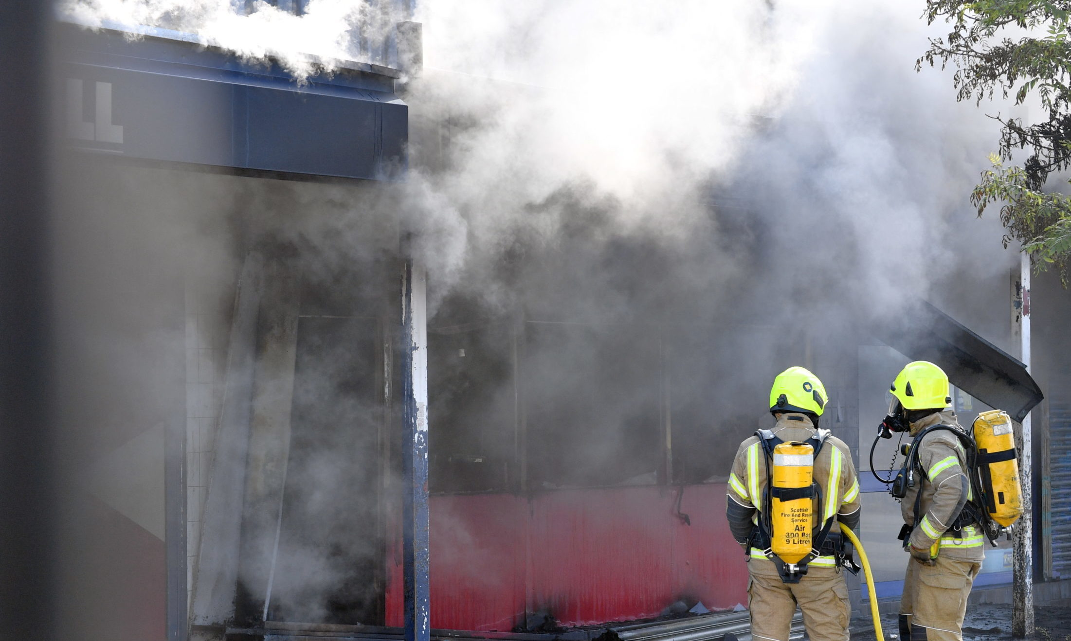 Crews spent two hours tackling the blaze at Byrons Fast Foods. Picture by Kami Thomson