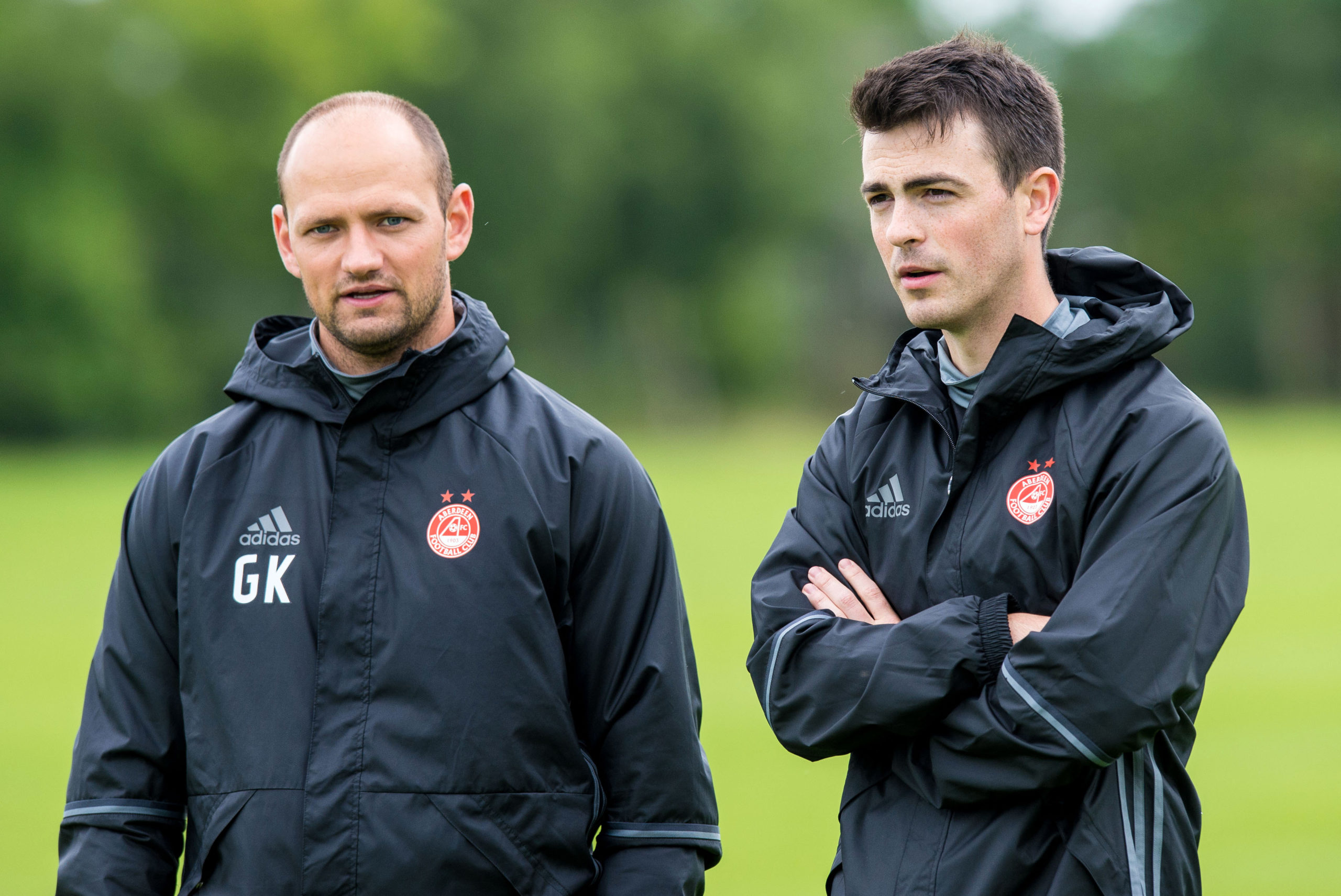 Aberdeen's Head of Medical & Football Science Adam Stokes (right)