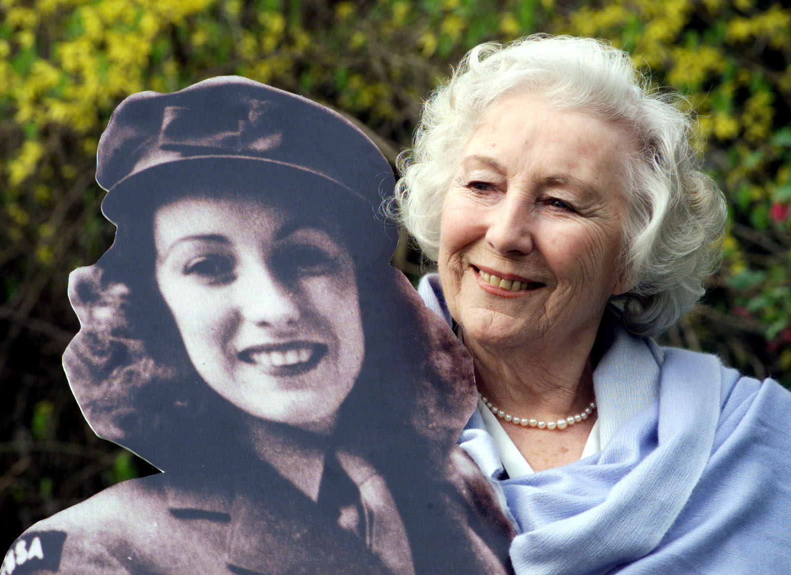 Dame Vera Lynn in the garden of the Savoy Hotel, after she was named personality of the century in a nationwide poll.