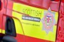 Fire crews attend a flat fire in Aberdeen this morning.