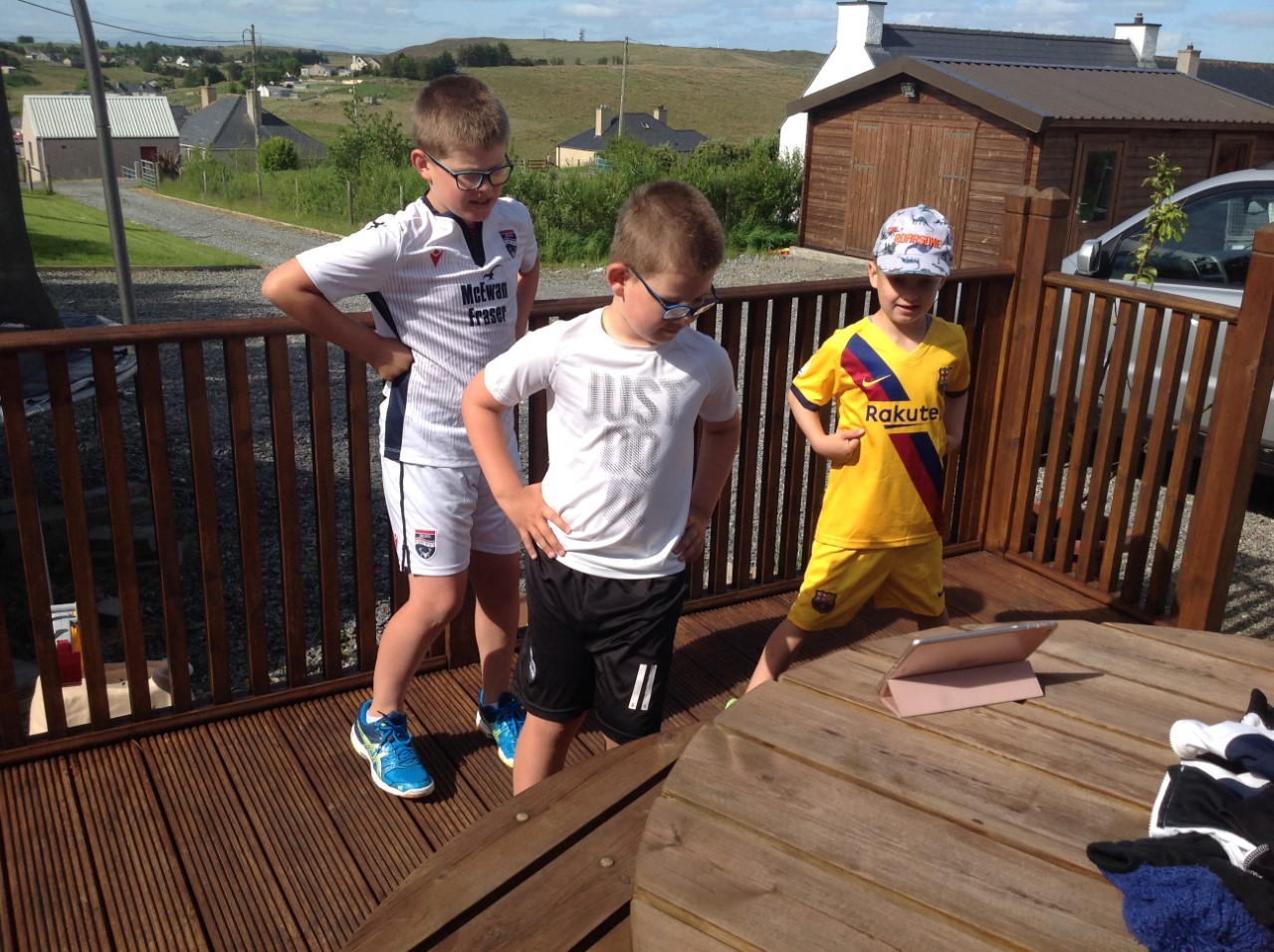 siblings Finlay, Lachlan and Fraser take part in the virtual sports day.