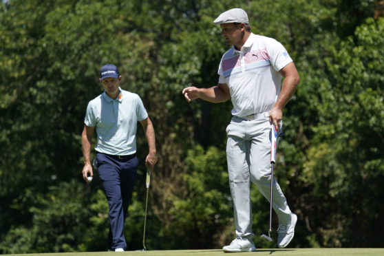 Bryson DeChambeau, right, has bulked up dramatically.