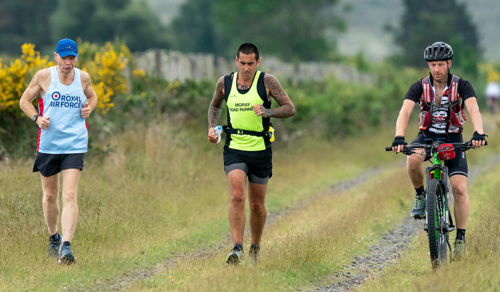 John Anderson, pictured centre, ran 100 miles to remember friend Jon Ward. Pictured left, Gareth Jenkins, right, Steven Morrison.