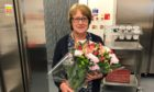 Katie Campbell has been recognised for serving up 1.8 million school meals over 45 years at the school