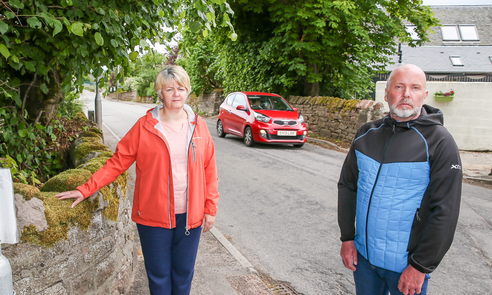Councillors Frances MacGruer and Duncan Chisholm at the Black Isle road junction in Muir of Ord