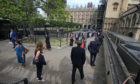 Members of Parliament queue outside the House of Commons
