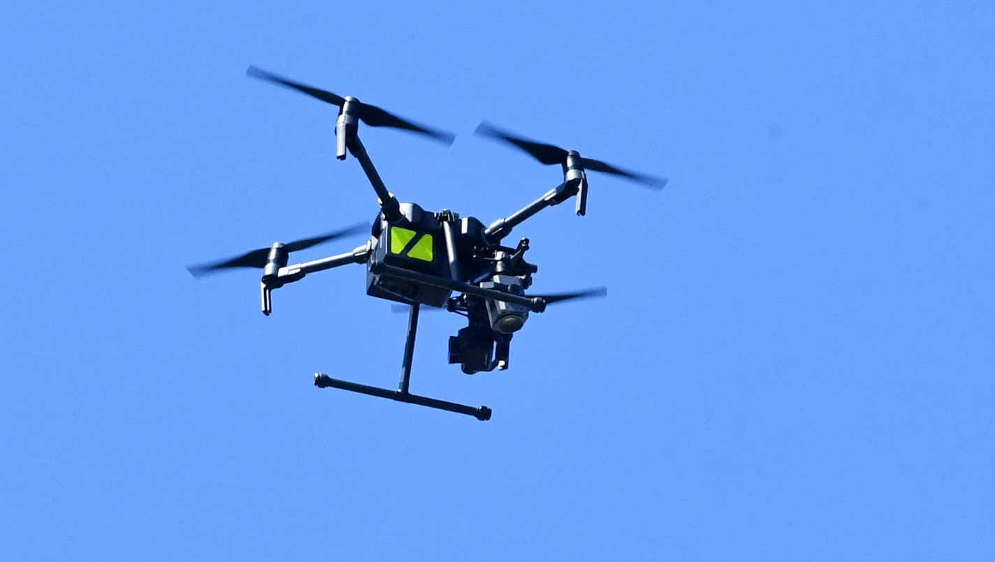 A police drone circles the scene of a fire at Clark Street in Hopeman.