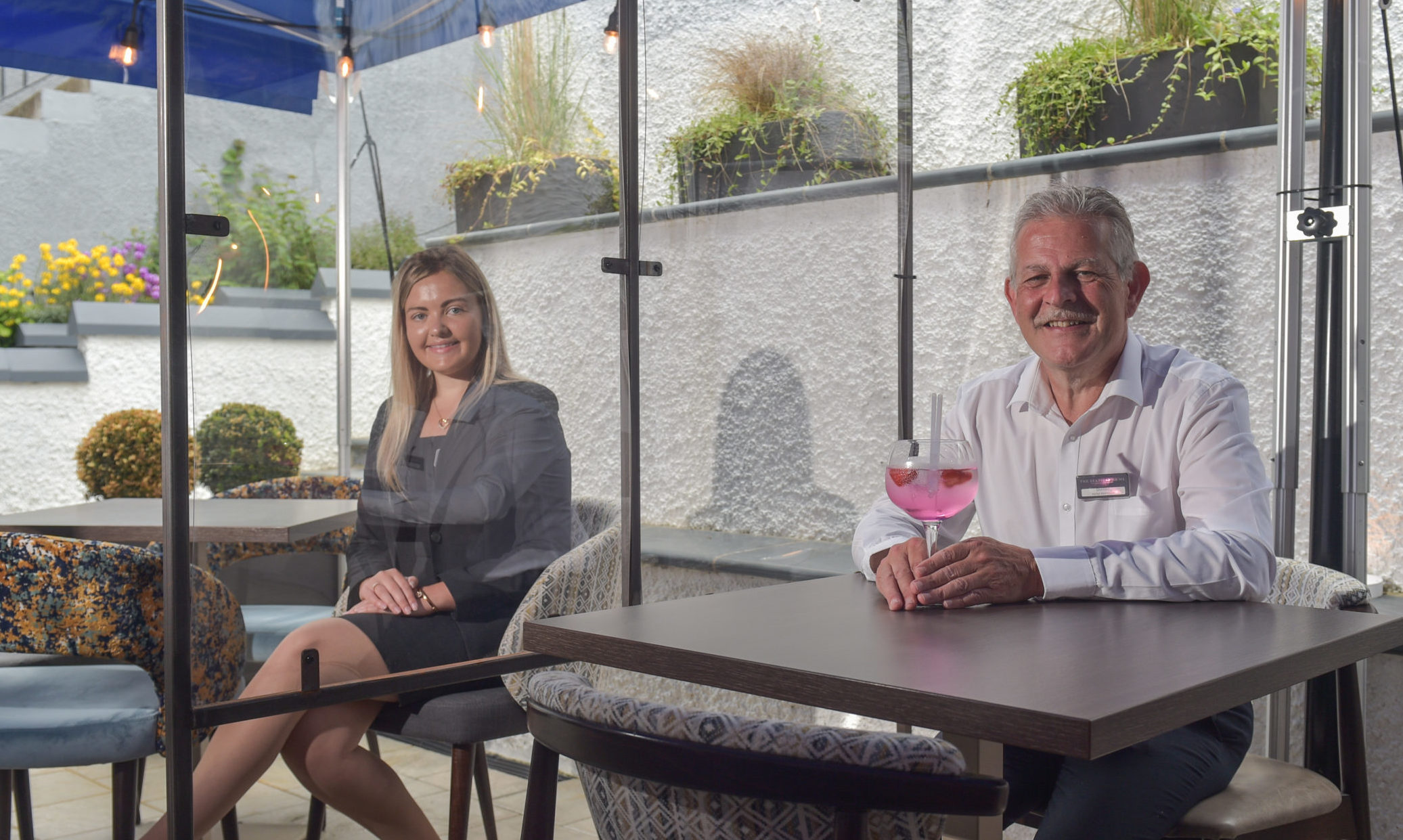 The Seafield Arms in Cullen has installed protective screens between tables for diners. Pictured: Manager Donald Thain, pictured right, and deputy manager Ailie Flett. Picture and video by Jason Hedges.