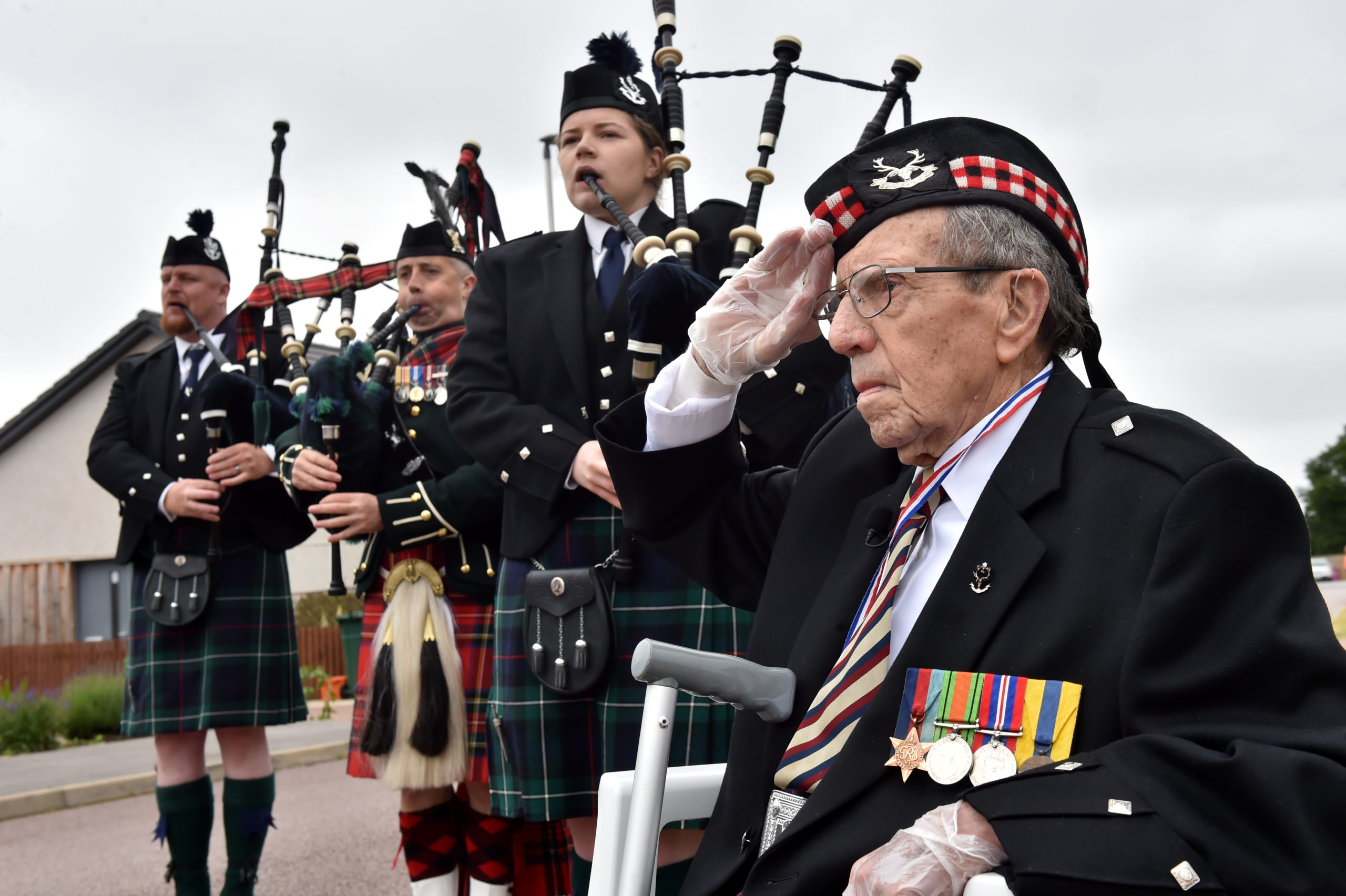 Donald Smith, pictured right, with pipers Jonathan Scott, Donald Stewart, Emma Lawrence. Picture: Kenny Elrick.