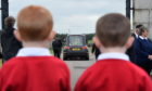 The Boys' Brigade members past and present formed a Guard of Honour from the gates at Kirkton Cemetery, Fraserburgh. Pictures by Kenny Elrick