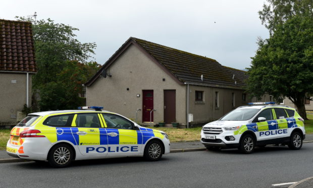Police at Scott Drive, near Scott Court, Huntly, following the incident. Picture by Kenny Elrick