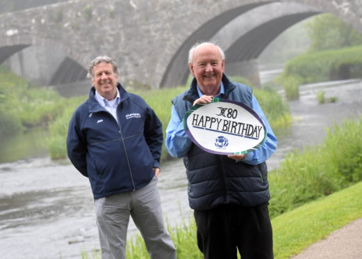 Aberdeen Grammar FP's Immediate Past-President Jim Rae presents Press and Journal and Evening Express' long-serving rugby correspondent Jack Nixon with an 80th birthday card.  Picture by Kath Flannery