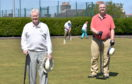 CR00221582      Coronavirus / Covid19 ;  Now that the lockdown has been eased, because we have entered phase one the paying of croquet is now allowed with some restrictions and social distancing. So members of the Aberdeen Saints Croquet Club have returned to their game at the Torry Outdoor Sports Centre, Victoria Road.      Pictured - Club captain Charles Henderson (left) with club secretary Quentin Stephens as Ralph Rotheroe and Pamela Rotheroe-Hay play.     Picture by Kami Thomson         01-06-2020