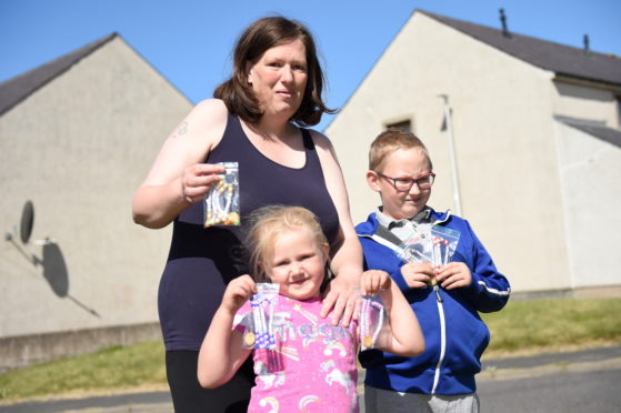 Nicola Mchattie and her children Logan (8) and Lana (5) have been making keyrings for key workers since the start of lockdown.