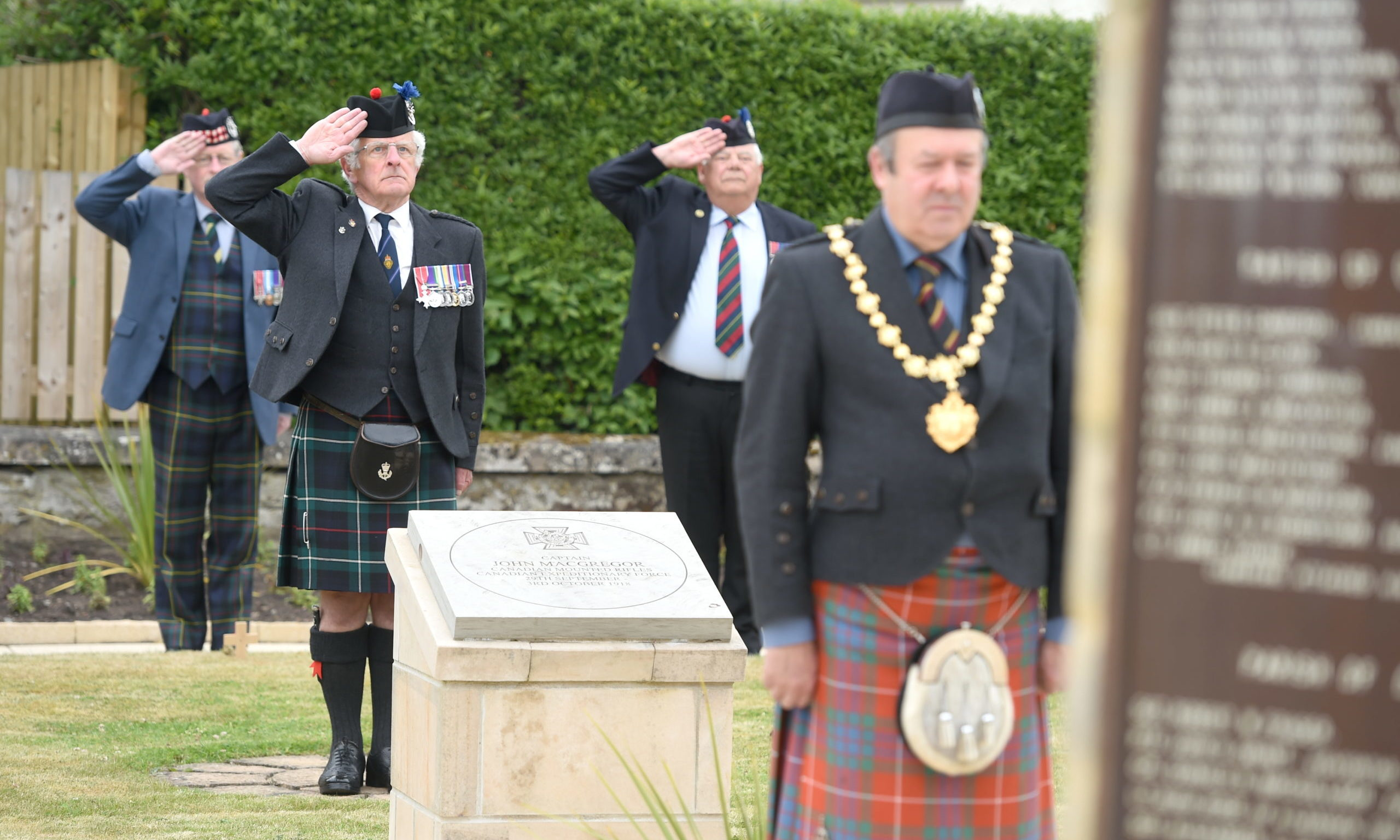 Lt Col Bob Towns leads the salute at the war memorial as Councillor Laurie Fraser lays a wreath. Picture by Sandy McCook