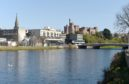 Picture by SANDY McCOOK    14th April '20 Inverness filers. Ness Bridge over th River Ness with Inverness Castle.