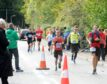 Runners during the 2018 marathon passing through Dores on the shores of Loch Ness. Picture by Sandy McCook