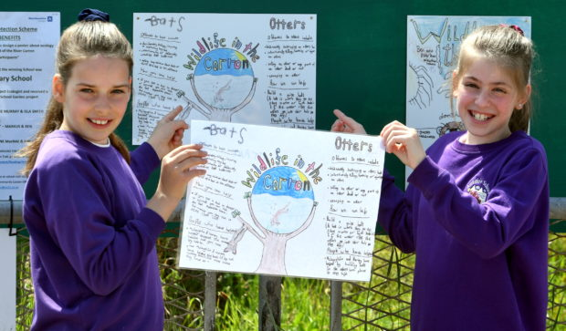 Pictured are from left, winning poster designers, Isla Smith 11, Lexie Murray 10. Picture by Chris Sumner.
