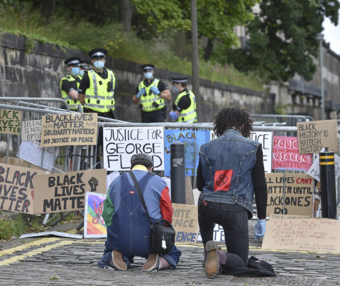 Demonstrators gathered outside the US consulate in Edinburgh