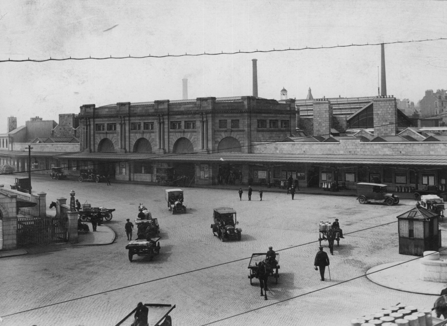 Horses and carts and more modern vehicles come and go from Aberdeen's Joint Station in the late 1800s.