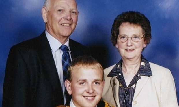Sandy Ingram, left, with wife Ann and son Andrew at his graduation.