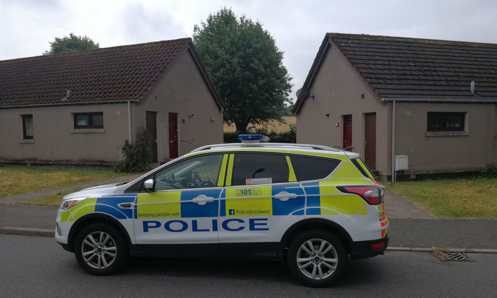 Police remain outside the property in Huntly. Picture by Kenny Elrick.