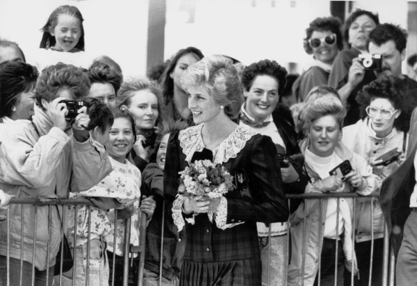 Diana, Princess of Wales, chats to the crowd after she opened the Harris Birthright Centre at Aberdeen Royal Infirmary in August 1989.