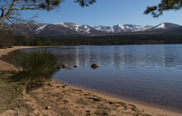 Loch Morlich pre-lockdown with the Cairngorms behind, part of the Cairngorm National Park.