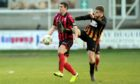 Neil McLean and Huntly's Alexander Jack. Picture by Colin Rennie