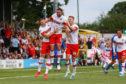 Clark Robertson of Rotherham United (C) celebrates a goal.