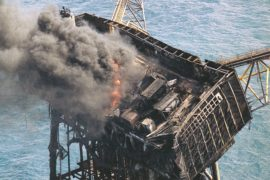 Thick smoke and flames still rise from the mangled remains of the Piper Alpha oil platform in the North Sea off the coast of Scotland in Aberdeen, July 8 1988.