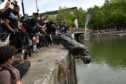 Protesters throw a statue of Edward Colston into Bristol harbour during a Black Lives Matter protest rally,