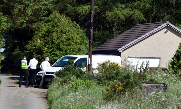 Police in Cuminestown following the death of Anthony McGladrigan.  Picture by Jim Irvine