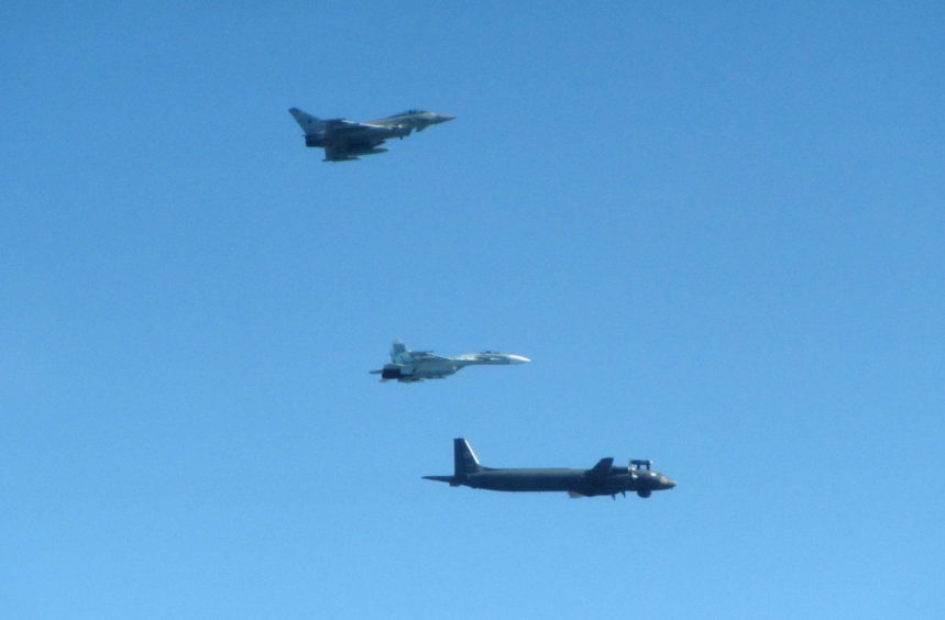 Image shows an intercept of a Russian IL-38 May and SU-27 Flanker B aircraft in Baltic Sea area by a RAF Typhoon