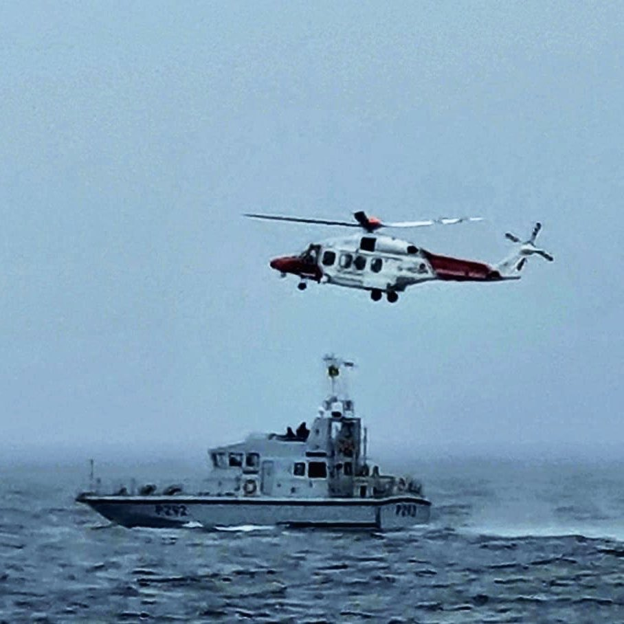 HMS Charger conducting search and rescue training with the Stornoway Maritime and Coastguard Agency helicopter.