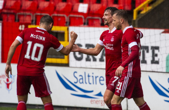 Aberdeen's Craig Bryson celebrates with Niall McGinn and Bruce Anderson after scoring to make it 1-0.