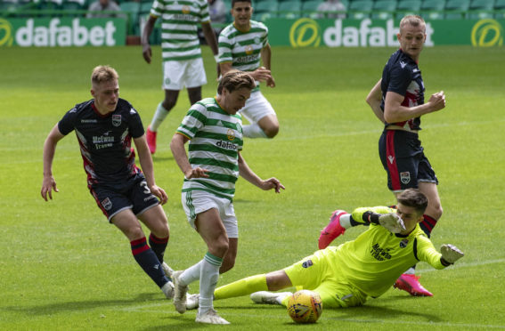 Celtic's James Forrest tries to go round trialist goalkeeper Ross Doohan during a pre-season friendly match between Celtic and Ross County at Celtic Park.